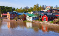 Summer Finnish landscape. Porvoo town, Finland. Wooden houses stand along the river coast