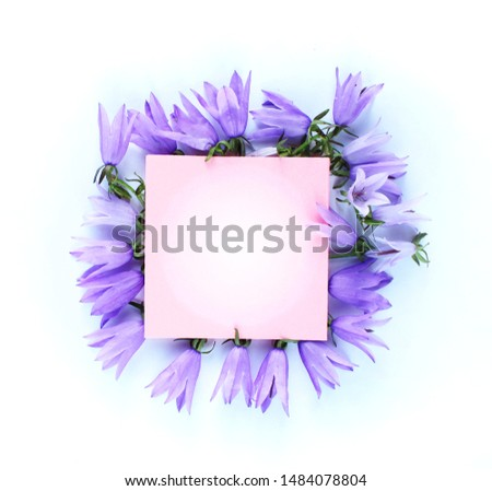 Summer flower arrangement of lilac bells on a white background. Background for congratulations and postcards. Delicate delicate shades. #1484078804