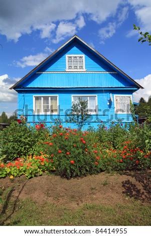 summer flowers near rural building - stock photo