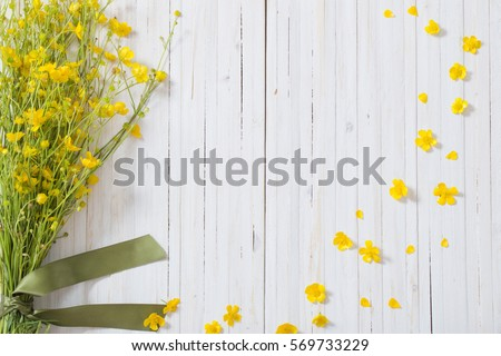 summer flowers on wooden background #569733229