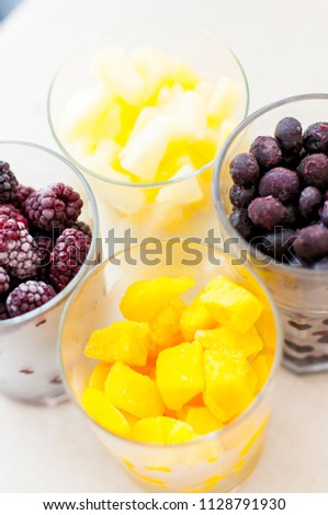 Summer fresh berries and fruits in the glass #1128791930