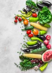 Summer fresh organic vegetables fruits harvest background. Organic garden vegetables, berries, fruit on a light background, top view