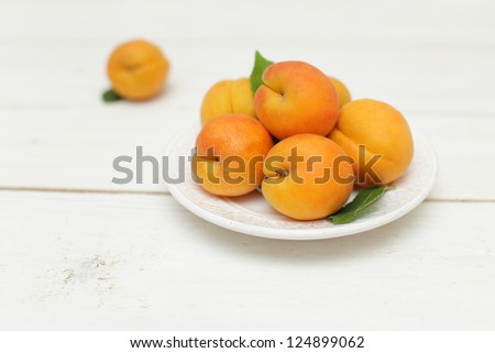 Summer fruit - apricots, white wooden background