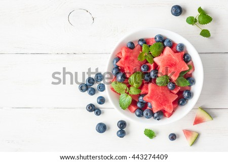Summer fruit salad of watermelon and blueberries. Slices of watermelon in the shape of a star. Top view, flat lay