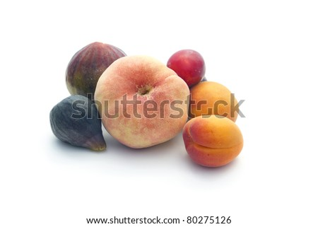 Summer fruits collection: peach, apricots, plums and figs isolated on white