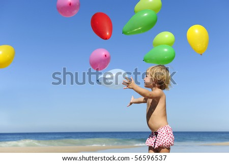 Summer fun: Child with ballons on the beach