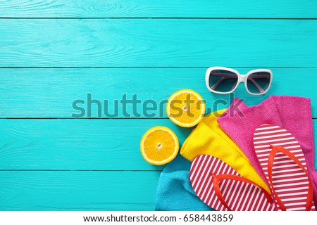 Summer fun. Fruits and accessories on blue wooden background. Top view and copy space. Mock up and picturesque. Fashion and beauty. Travel #658443859