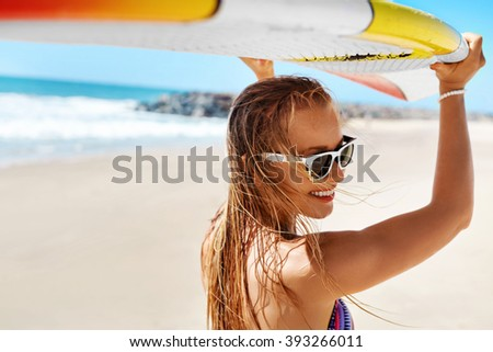 Summer Fun On Holidays Travel Vacation. Surfing. Sexy Beautiful Surfer Girl In Bikini With Surfboard. Healthy Lifestyle. Extreme Water Sports. Summertime Leisure Activity. Hobby. Wellness Concept