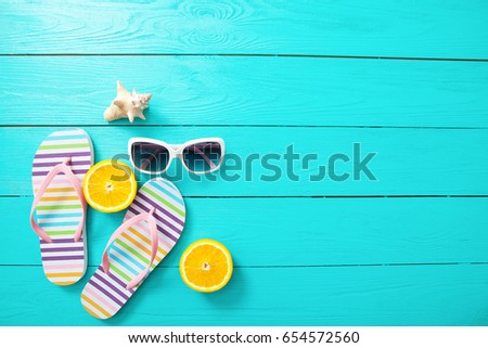 Summer fun time and accessories on blue wooden background. Mock up and copy space #654572560