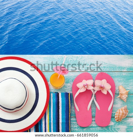 9d77c0bee Summer fun time and accessories on blue wooden background. Trendy summer  accessories on pool.