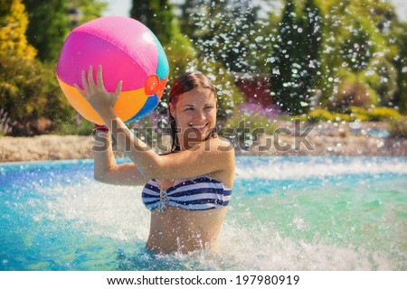 Summer game / Young woman playing with a beachball
