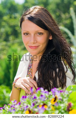 Summer garden beautiful young woman smiling flowers