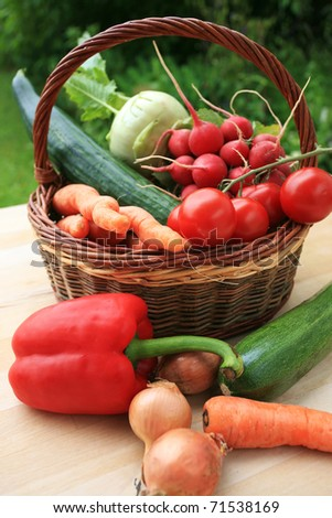 Summer garden harvest on table - stock photo