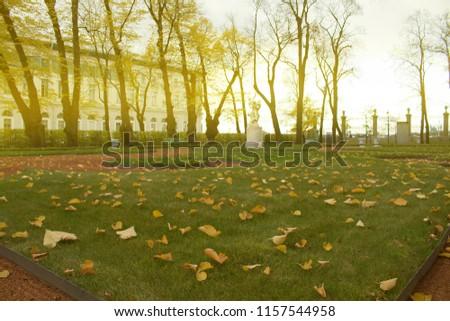 Summer garden in St. Petersburg. Sculpture the Rape of the Sabines and classical building. Autumn in Park and on streets, defoliation, yellow leaves. Walking along city streets and alleys of Park