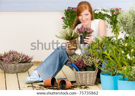 Summer garden terrace redhead woman hold potted flower
