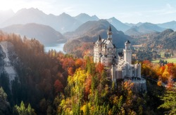 Summer Germany. Morning in the Bavarian Mountains. Castle Neuschwanstein in the light of the rising sun. Awesome alpine highlands in sunny day.  Popular Photography Locations. Beautiful of the world.