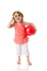 Summer girl wearing sunglasses holding ball laughing isolated on white