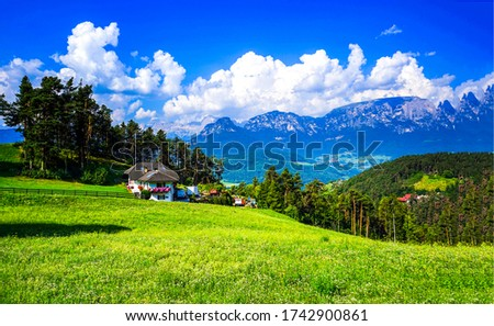 Summer green mountain hill house landscape. Mountain farm house view