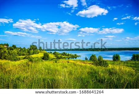 Summer green nature river shore landscape. River nature in summer. Summer river shore landscape