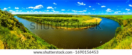 Summer green river turn panoramic landscape. Panorama summer river valley. River valley panoramic landscape. Summer valley river panorama