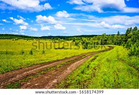 Summer green rural road landscape. Rural summer road view. Rural road in summer. Summer rural road landscape