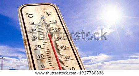 Summer heat, high temperature outdoors, hot desert weather. Thermometer reaching 100 degrees Fahrenheit scale on blue sky background, sunny day. 3d illustration