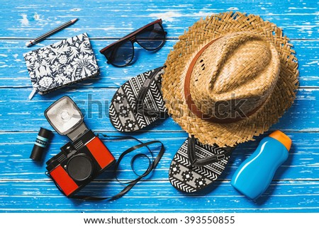 Summer holiday background, Beach accessories on blue distressed wood table, Vacation and travel items