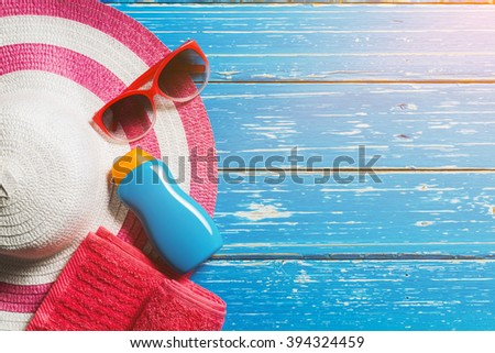 Summer holiday background, Beach accessories on blue distressed wood table, Vacation and travel items #394324459