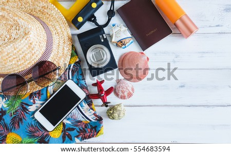 Summer holiday background, Beach accessories on white wood and copy space ,Vacation and travel items concept. #554683594