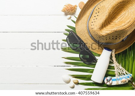 Summer holiday background, Beach accessories on white wood table, Vacation and travel items