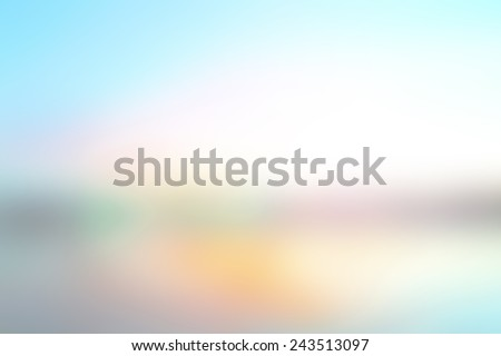 Summer holiday concept: Abstract blur beach with yellow and blue sky sunrise background. #243513097