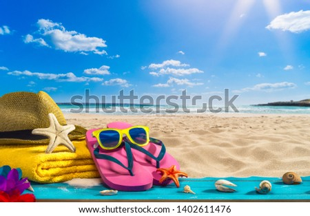 Summer holiday concept, beach accessories on wooden plank #1402611476