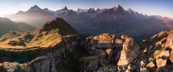 Summer holiday season. Sunrise view on Bernese range above Bachalpsee lake. Highest peaks Eiger, Jungfrau and Schreckhorn in famous location. Switzerland alps, Grindelwald valley. Travel background