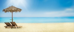 Summer holiday travel background. Tropical island luxury resort hotel vacation. Sun umbrella and chairs on sandy beach.