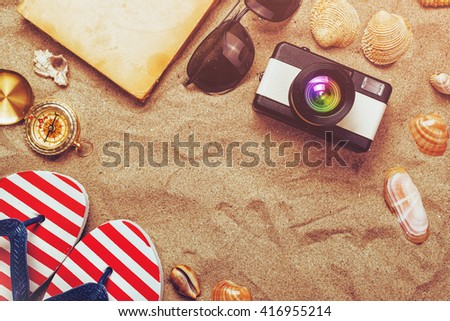 Summer holiday vacation accessories on beach sand, lifestyle objects in flat lay top view arrangement. #416955214