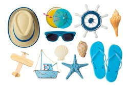 Summer holiday vacation concept with beach and travel accessories isolated on white background. Top view from above