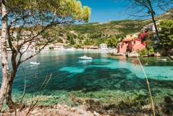 Summer holiday vacation in Greece. Transparent mediterranean cove and small town Assos. Kefalonia Greece