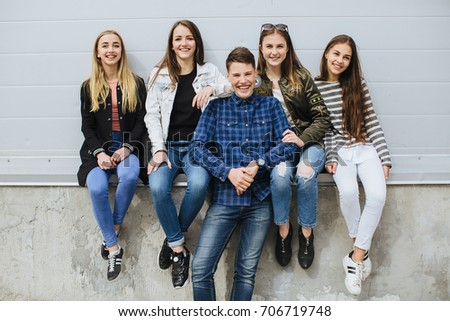 Summer holidays and teenage concept - group of smiling teenagers with skateboard hanging out outside. #706719748