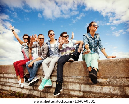 Summer holidays and teenage concept group of teenagers for Hanging groups of pictures