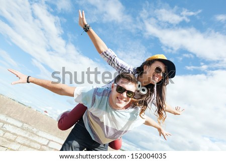 summer holidays and teenage concept - teenagers having fun outside #152004035