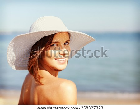 Shutterstock summer holidays and vacation concept - girl in bikini standing on the beach