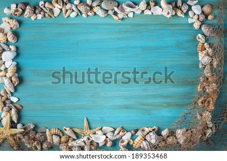 Summer holidays background in blue with fishing net ans seashells and a space for advertising