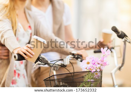 summer holidays bikes love relationship and dating concept closeup of couple holding coffee and riding bicycle