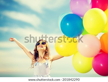 summer holidays celebration family children and people concept happy girl with colorful balloons