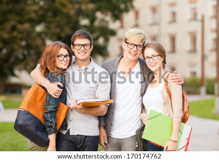summer holidays education campus and teenage concept group of students or teenagers with files folders and eyeglasses hanging out