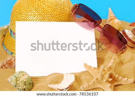 summer holidays memories card from beach with shells,hat and sunglasses on sand