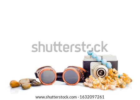Summer holidays objets isolated on white background, retro photo camera, vintage airplane pilot glasses, sea shell necklace and beach stones Photo stock ©