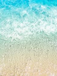 summer holidays seaside beach blue lagoon paradise foam waves on sand top view vertical
