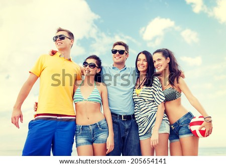 summer, holidays, vacation, happy people concept - group of friends having fun on the beach #205654141
