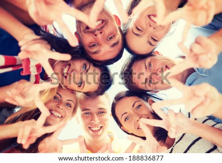 summer, holidays, vacation, happy people concept - group of teenagers looking down and showing finger five gesture #188836877
